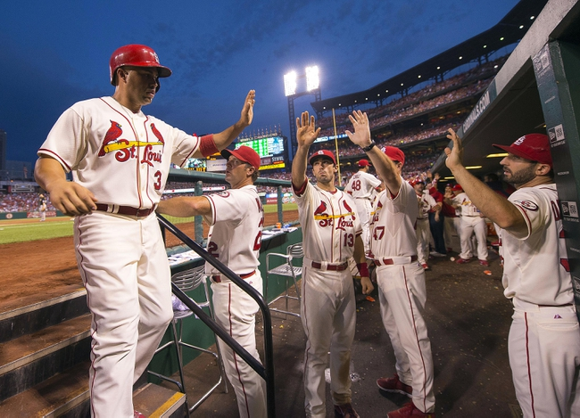 Sep 7, 2013; St. Louis, MO, USA; St. Louis Cardinals right fielder Carlos Beltran (3) is congratulated after scoring a run against the Pittsburgh Pirates at Busch Stadium. The Cardinals defeated the Pirates 5-0. Mandatory Credit: Scott Rovak-USA TODAY Sports