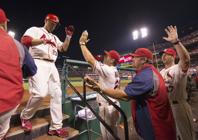 Sep 7, 2013; St. Louis, MO, USA; St. Louis Cardinals third baseman David Freese (23) is congratulated after hitting a home run against the Pittsburgh Pirates at Busch Stadium. The Cardinals defeated the Pirates 5-0. Mandatory Credit: Scott Rovak-USA TODAY Sports