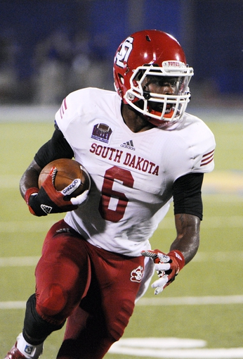 Sep 7, 2013; Lawrence, KS, USA; South Dakota Coyotes wide receiver Terrance Terry (6) runs with the ball against the Kansas Jayhawks in the second half at Memorial Stadium. Kansas won the game 31-14. Mandatory Credit: John Rieger-USA TODAY Sports