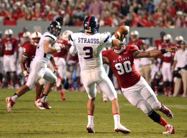Sep 7, 2013; Raleigh, NC, USA;Richmond Spiders quarterback Michael Strauss (3) passes as he is pressured by North Carolina State Wolfpack defensive end Mike Rose (90) at Carter Finley Stadium.  North Carolina State won 23-21. Mandatory Credit: Rob Kinnan-USA TODAY Sports