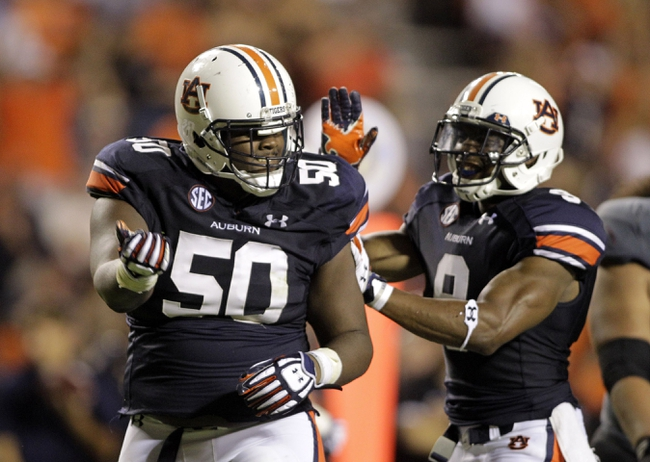 Sep 7, 2013; Auburn, AL, USA; Auburn Tigers defensive tackle Ben Bradley (50) celebrates with defensive back Jermaine Whitehead (9) after a play during the second half against the Arkansas State Red Wolves at Jordan Hare Stadium.  Mandatory Credit: John Reed-USA TODAY Sports