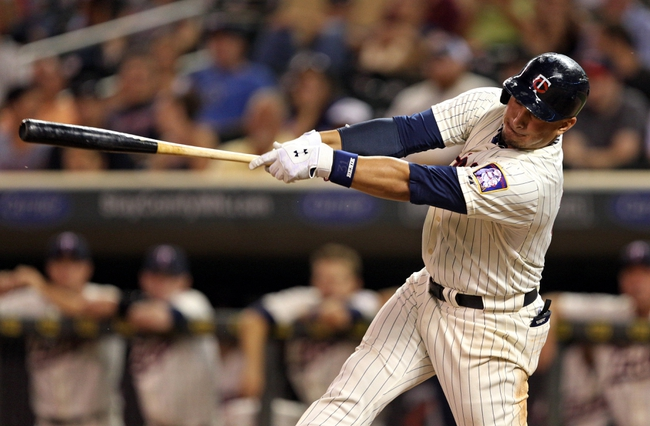 Sep 7, 2013; Minneapolis, MN, USA; Minnesota Twins left fielder Oswaldo Arcia (31) hits a single in the eighth inning against the Toronto Blue Jays at Target Field. The Blue Jays won 11-2. Mandatory Credit: Jesse Johnson-USA TODAY Sports