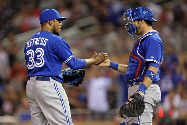 Sep 7, 2013; Minneapolis, MN, USA; Toronto Blue Jays relief pitcher Jeremy Jeffress (33) celebrates with catcher J.P. Arencibia (9) after beating the Minnesota Twins at Target Field. The Blue Jays won 11-2. Mandatory Credit: Jesse Johnson-USA TODAY Sports
