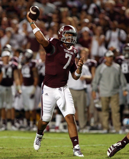 Sep 7, 2013; College Station, TX, USA; Texas A&M Aggies quarterback Kenny Hill (7) throws a touchdown pass during the third quarter against the Sam Houston State Bearkats at Kyle Field. Mandatory Credit: Troy Taormina-USA TODAY Sports