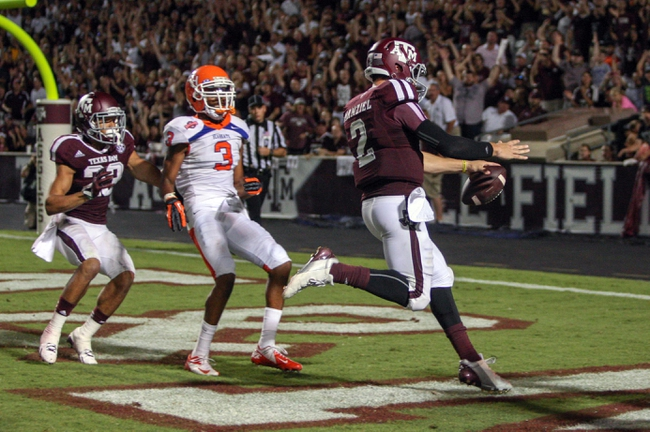 Sep 7, 2013; College Station, TX, USA; Texas A&M Aggies quarterback Johnny Manziel (2) scores a touchdown during the third quarter against the Sam Houston State Bearkats at Kyle Field. Mandatory Credit: Troy Taormina-USA TODAY Sports