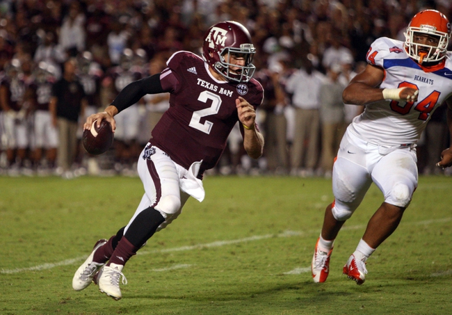 Sep 7, 2013; College Station, TX, USA; Texas A&M Aggies quarterback Johnny Manziel (2) rushes for a touchdown during the third quarter against the Sam Houston State Bearkats at Kyle Field. Mandatory Credit: Troy Taormina-USA TODAY Sports
