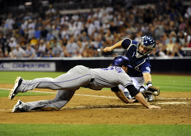 Sep 7, 2013; San Diego, CA, USA; Colorado Rockies infielder charlie Culberson (23) slides around a tag by San Diego Padres catcher Nick Hundley (4) to tie the game during the eighth inning at Petco Park. Mandatory Credit: Christopher Hanewinckel-USA TODAY Sports