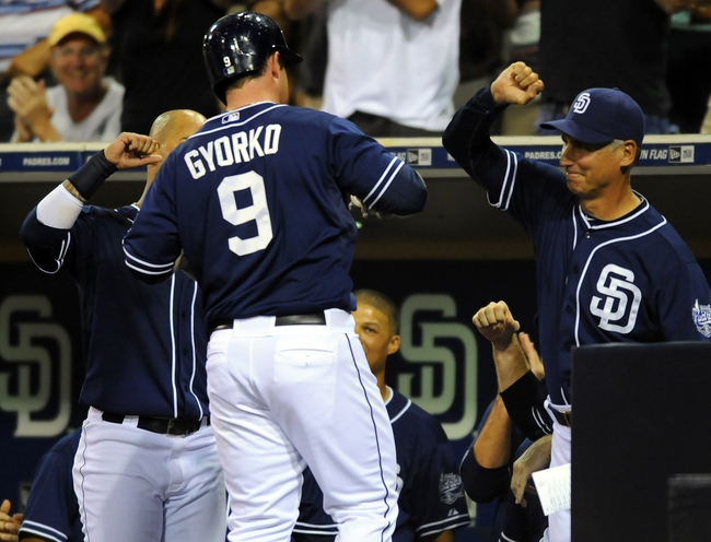 Sep 7, 2013; San Diego, CA, USA; San Diego Padres second baseman Jedd Gyorko (9) is congratulated by manager Bud Black (right) after a go-ahead home run during the eighth inning against the Colorado Rockies at Petco Park. Mandatory Credit: Christopher Hanewinckel-USA TODAY Sports