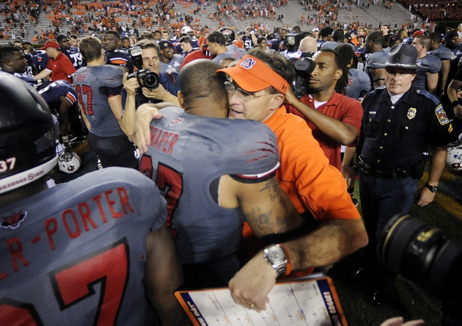 Sep 7, 2013; Auburn, AL, USA; Auburn Tigers head coach Gus Malzahn hugs Arkansas State Red Wolves defensive lineman Amos Draper (97) after the game at Jordan Hare Stadium. Auburn defeated the Arkansas State 38-9. Mandatory Credit: Shanna Lockwood-USA TODAY Sports