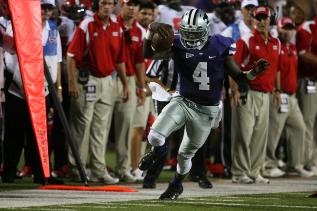 Sep 7, 2013; Manhattan, KS, USA; Kansas State Wildcats quarterback Daniel Sams (4) tries to stay in bounds during a 48-27 win against the Louisiana-Lafayette Ragin Cajuns at Bill Snyder Family Stadium. Mandatory Credit: Scott Sewell-USA TODAY Sports