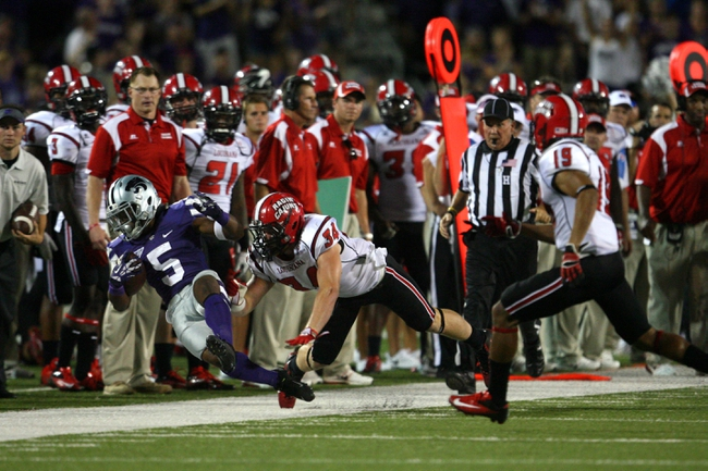 Sep 7, 2013; Manhattan, KS, USA; Kansas State Wildcats running back Robert Rose (5) is pushed out of bounds by Louisiana-Lafayette Ragin Cajuns linebacker Justin Anderson (34) during the Wildcats' 48-27 win at Bill Snyder Family Stadium. Mandatory Credit: Scott Sewell-USA TODAY Sports