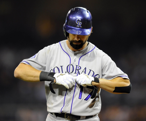 Sep 7, 2013; San Diego, CA, USA; Colorado Rockies first baseman Todd Helton (17) reacts after getting out during the ninth inning against the San Diego Padres at Petco Park. The Padres won 2-1. Mandatory Credit: Christopher Hanewinckel-USA TODAY Sports