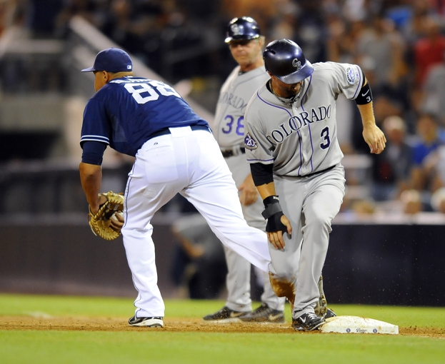 Sep 7, 2013; San Diego, CA, USA; Colorado Rockies right fielder Michael Cuddyer (3) is doubled off first base on a force play by San Diego Padres first baseman Kyle Blanks (88) during the ninth inning  at Petco Park. The Padres won 2-1. Mandatory Credit: Christopher Hanewinckel-USA TODAY Sports