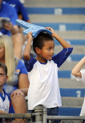 Sep 7, 2013; Lawrence, KS, USA; A fans watches the game between the South Dakota Coyotes and Kansas Jayhawks at Memorial Stadium. Kansas won the game 31-14. Mandatory Credit: John Rieger-USA TODAY Sports