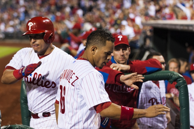 Sep 7, 2013; Philadelphia, PA, USA; Philadelphia Phillies center fielder Cesar Hernandez (16) celebrates scoring during the eighth inning against the Atlanta Braves at Citizens Bank Park. The Phillies defeated the Braves 6-5. Mandatory Credit: Howard Smith-USA TODAY Sports