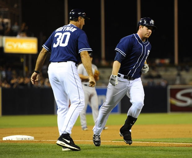 Sep 7, 2013; San Diego, CA, USA; San Diego Padres second baseman Jedd Gyorko (9) is congratulated by third base coach Glenn Hoffman (30) after a home run during the eighth inning against the Colorado Rockies at Petco Park. Mandatory Credit: Christopher Hanewinckel-USA TODAY Sports
