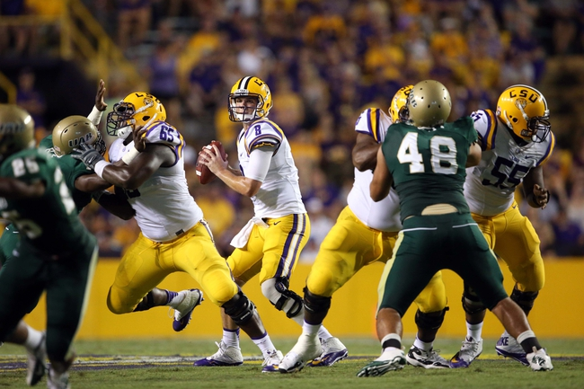 Sep 7, 2013; Baton Rouge, LA, USA; LSU Tigers quarterback Zach Mettenberger (8) looks to pass the ball against the UAB Blazers in the second half at Tiger Stadium. LSU defeated UAB 56-17. Mandatory Credit: Crystal LoGiudice-USA TODAY Sports