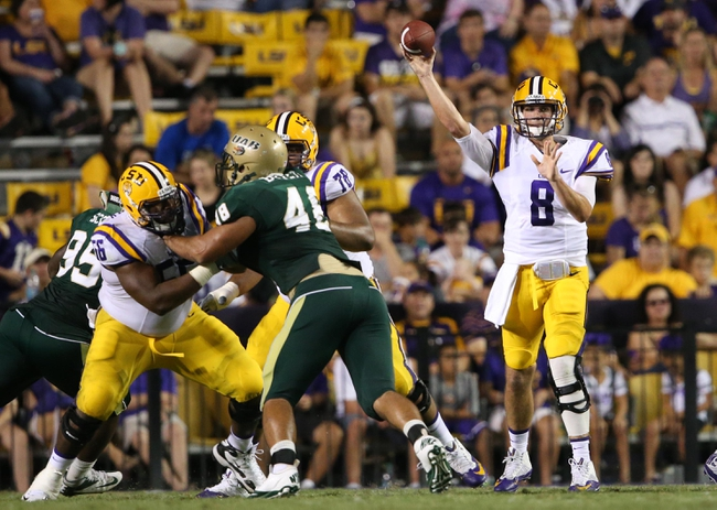 Sep 7, 2013; Baton Rouge, LA, USA; LSU Tigers quarterback Zach Mettenberger (8) passes in the ball against the UAB Blazers in the second half at Tiger Stadium. LSU defeated UAB 56-17. Mandatory Credit: Crystal LoGiudice-USA TODAY Sports