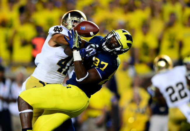 Sep 7, 2013; Ann Arbor, MI, USA; Michigan Wolverines tight end Devin Funchess (87) is unable to make a catch while being defended by Notre Dame Fighting Irish safety Matthias Farley (41) during the fourth quarter at Michigan Stadium. Mandatory Credit: Andrew Weber-USA TODAY Sports