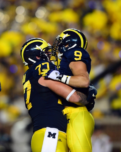 Sep 7, 2013; Ann Arbor, MI, USA; Michigan Wolverines wide receiver Drew Dileo (9) celebrates with offensive linesman Chris Fox (73) after catching a pass for a touchdown during the fourth quarter against the Notre Dame Fighting Irish at Michigan Stadium. Mandatory Credit: Andrew Weber-USA TODAY Sports