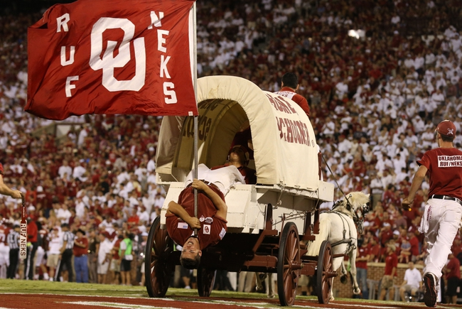 Sep 7, 2013; Norman, OK, USA; Oklahoma Sooners rub nek hangs out the back of the Sooner Schooner as it takes the field after a field goal was scored in the second half against West Virginia Mountaineers safety Karl Joseph (8) at Gaylord Family - Oklahoma Memorial Stadium. The Oklahoma Sooners beat the West Virginia Mountaineers 16-7. Mandatory Credit: Matthew Emmons-USA TODAY Sports