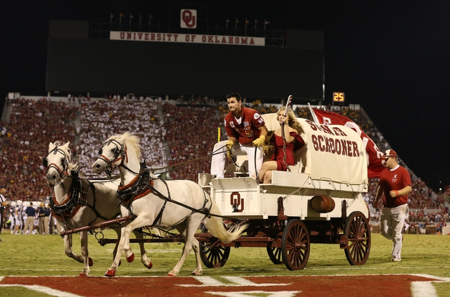 Sep 7, 2013; Norman, OK, USA; Oklahoma Sooners Schooner takes the field after a field goal was scored in the second half against West Virginia Mountaineers safety Karl Joseph (8) at Gaylord Family - Oklahoma Memorial Stadium. The Oklahoma Sooners beat the West Virginia Mountaineers 16-7. Mandatory Credit: Matthew Emmons-USA TODAY Sports