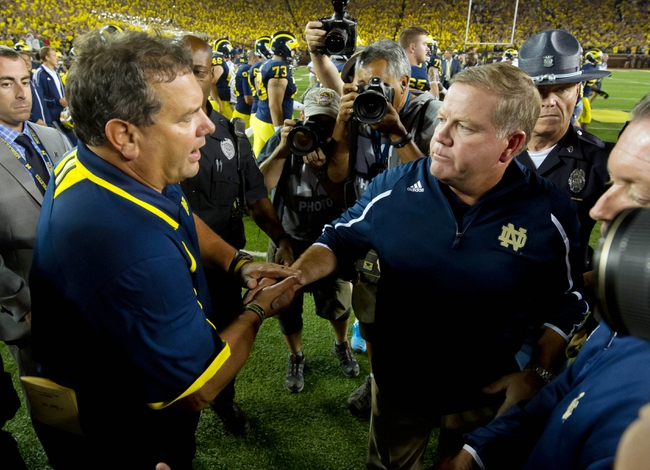 Sep 7, 2013; Ann Arbor, MI, USA; Michigan Wolverines head coach Brady Hoke and Notre Dame Fighting Irish head coach Brian Kelly shake hands after Michigan defeated Notre Dame 41-30 at Michigan Stadium. Mandatory Credit: Matt Cashore-USA TODAY Sports