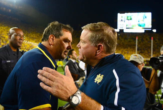 Sep 7, 2013; Ann Arbor, MI, USA; Michigan Wolverines head coach Brady Hoke (left) and Notre Dame Fighting Irish head coach Brian Kelly shake hands after Michigan defeated Notre Dame 41-30 at Michigan Stadium. Mandatory Credit: Andrew Weber-USA TODAY Sports