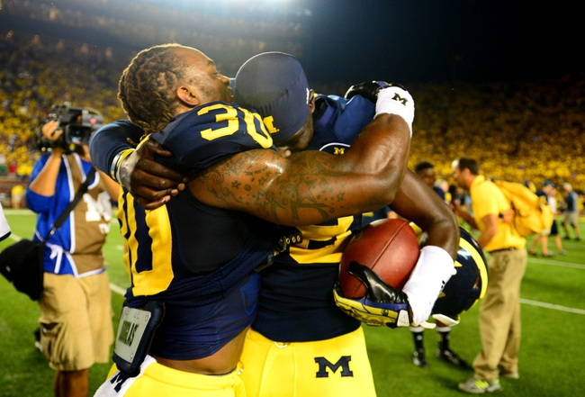 Sep 7, 2013; Ann Arbor, MI, USA; Michigan Wolverines quarterback Devin Gardner (98) and safety Thomas Gordon (30) celebrate after defeating Notre Dame Fighting Irish 41-30 at Michigan Stadium. Mandatory Credit: Andrew Weber-USA TODAY Sports