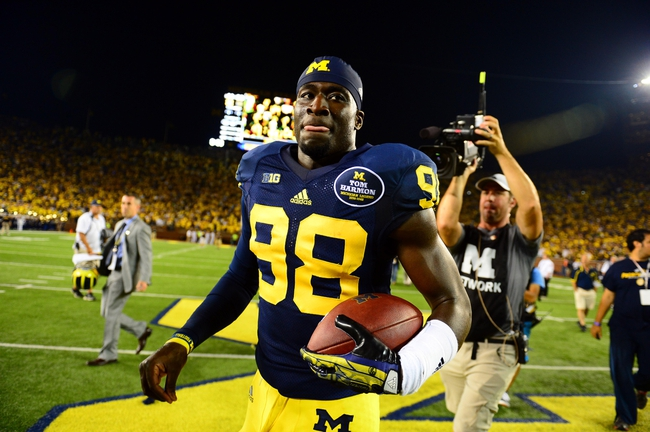 Sep 7, 2013; Ann Arbor, MI, USA; Michigan Wolverines quarterback Devin Gardner (98) runs off the field after defeating Notre Dame Fighting Irish 41-30 at Michigan Stadium. Mandatory Credit: Andrew Weber-USA TODAY Sports