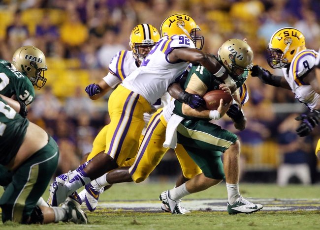 Sep 7, 2013; Baton Rouge, LA, USA; UAB Blazers quarterback Austin Brown (11) is sacked by LSU Tigers defensive end Lewis Neal (92) in the fourth quarter at Tiger Stadium. LSU defeated UAB 56-17. Mandatory Credit: Crystal LoGiudice-USA TODAY Sports