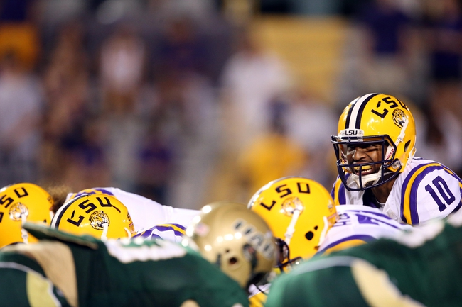 Sep 7, 2013; Baton Rouge, LA, USA; LSU Tigers quarterback Anthony Jennings (10) yells prior to the snap against the UAB Blazers at Tiger Stadium. LSU defeated UAB 56-17. Mandatory Credit: Crystal LoGiudice-USA TODAY Sports