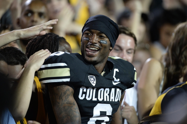 Sep 7, 2013; Boulder, CO, USA; Colorado Buffaloes wide receiver Paul Richardson (6) reacts in the stands following the win over the Central Arkansas Bears at Folsom Field. The Buffaloes defeated the Bears 38-24. Mandatory Credit: Ron Chenoy-USA TODAY Sports
