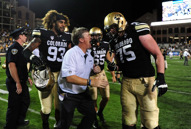 Sep 7, 2013; Boulder, CO, USA; Colorado Buffaloes head coach Mike Macintyre reacts with defensive lineman Samson Kafovalu (93) and long snapper Keegan LaMar (65) and offensive linesman Jack Harris (75)  following the win over the Central Arkansas Bears at Folsom Field. The Buffaloes defeated the Bears 38-24. Mandatory Credit: Ron Chenoy-USA TODAY Sports
