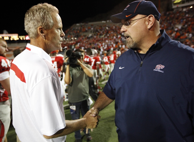 Sep 7, 2013; El Paso, TX, USA; New Mexico head coach Bob Davie, left, and UTEP head coach Sean Kugler shake hands after the Lobs defeated the Miners in overtime at Sun Bowl Stadium. Mandatory Credit: Ivan Pierre Aguirre-USA TODAY Sports