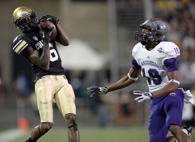 Sep 7, 2013; Boulder, CO, USA; Colorado Buffaloes wide receiver Paul Richardson (6) pulls in a reception as Central Arkansas Bears defensive back Marcus Peters (19) defends in the third quarter at Folsom Field. The Buffaloes defeated the Bears 38-24. Mandatory Credit: Ron Chenoy-USA TODAY Sports