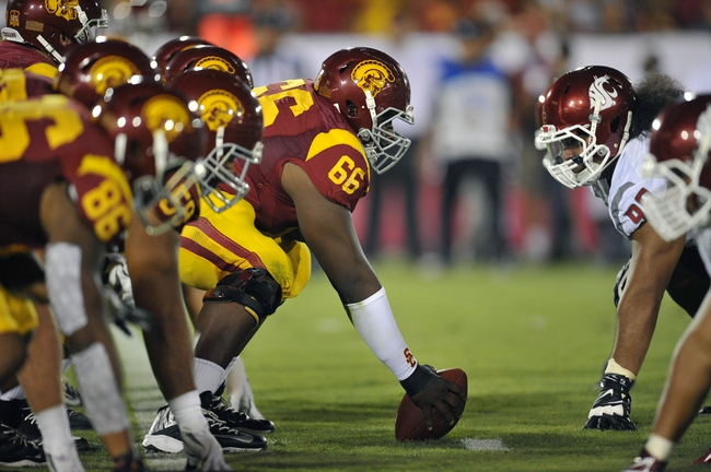 September 7, 2013; Los Angeles, CA, USA; Southern California Trojans guard Marcus Martin (66) lines up before snapping the ball against the Washington State Cougars during the first half at the Los Angeles Memorial Coliseum. Mandatory Credit: Gary A. Vasquez-USA TODAY Sports