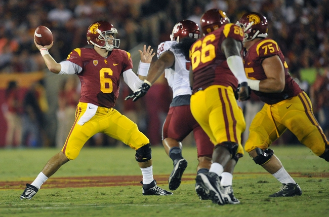 September 7, 2013; Los Angeles, CA, USA; Southern California Trojans quarterback Cody Kessler (6) passes under pressure against the Washington State Cougars during the first half at the Los Angeles Memorial Coliseum. Mandatory Credit: Gary A. Vasquez-USA TODAY Sports