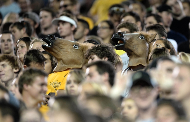 Sep 7, 2013; Boulder, CO, USA; Colorado Buffaloes student fans wear horse masks during the fourth quarter against the Central Arkansas Bears at Folsom Field. The Buffaloes defeated the Bears 38-24. Mandatory Credit: Ron Chenoy-USA TODAY Sports