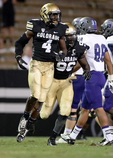 Sep 7, 2013; Boulder, CO, USA; Colorado Buffaloes defensive back Chidobe Awuzie (4) reacts with defensive lineman Chidera Uzo-Diribe (96) following his interception in the fourth quarter against the  Central Arkansas Bears at Folsom Field. The Buffaloes defeated the Bears 38-24. Mandatory Credit: Ron Chenoy-USA TODAY Sports