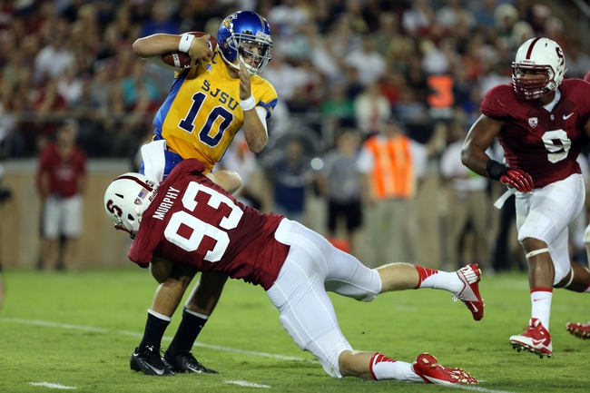 Sep 7, 2013; Stanford, CA, USA; Stanford Cardinal linebacker Trent Murphy (93) sacks San Jose State Spartans quarterback David Fales (10) during the second quarter at Stanford Stadium. Mandatory Credit: Kelley L Cox-USA TODAY Sports