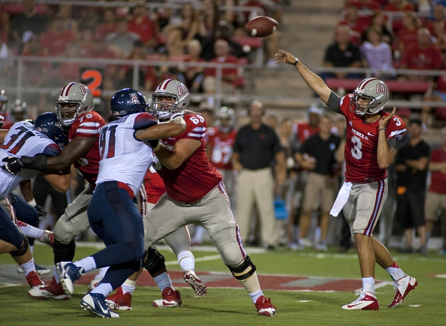 Sep 7, 2013; Las Vegas, NV, USA; UNLV Rebels quarterback Nick Sherry releases a pass attempt against the visiting Arizona Wildcats during an NCAA football game at Sam Boyd Stadium. Mandatory Credit: Stephen R. Sylvanie-USA TODAY Sports