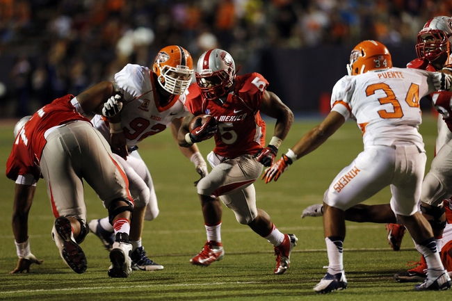 Sep 7, 2013; El Paso, TX, USA; New Mexico Lobos running back Kasey Carrier (5) breaks for a touchdown against the UTEP Miners at Sun Bowl Stadium. The Lobos beat the Miners 42-35 in overtime. Mandatory Credit: Ivan Pierre Aguirre-USA TODAY Sports