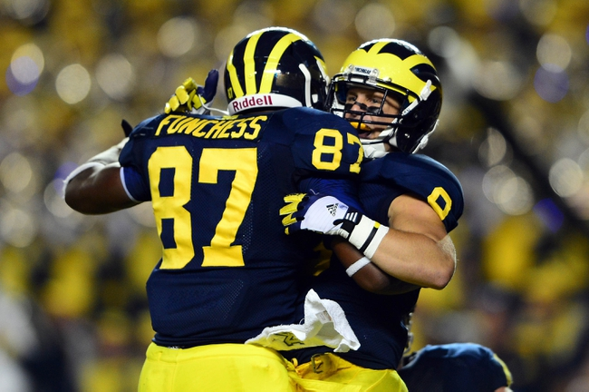 Sep 7, 2013; Ann Arbor, MI, USA; Michigan Wolverines tight end Devin Funchess (87) celebrates with wide receiver Drew Dileo (9) after catching a pass for a touchdown during the fourth quarter against the Notre Dame Fighting Irish at Michigan Stadium. Michigan Wolverines defeated Notre Dame Fighting Irish 41-30. Mandatory Credit: Andrew Weber-USA TODAY Sports