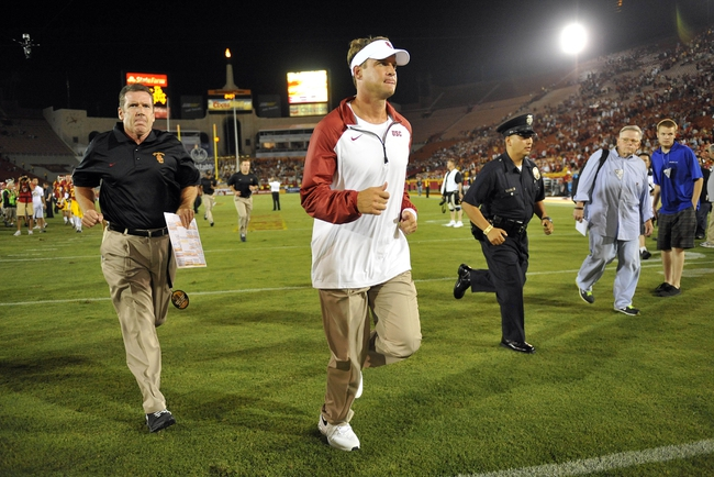 September 7, 2013; Los Angeles, CA, USA; Southern California Trojans head coach Lane Kiffin runs off the field following the 10-7 loss against the Washington State Cougars at the Los Angeles Memorial Coliseum. Mandatory Credit: Gary A. Vasquez-USA TODAY Sports