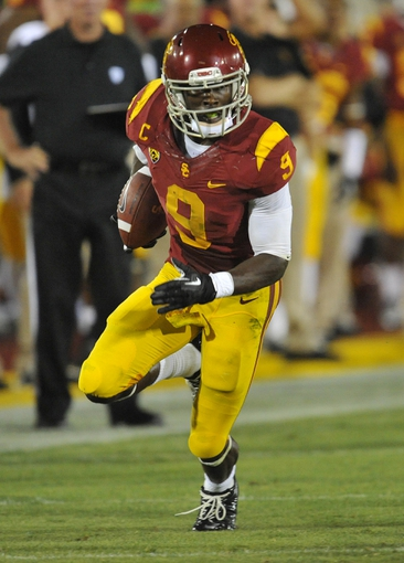 September 7, 2013; Los Angeles, CA, USA; Southern California Trojans wide receiver Marqise Lee (9) runs the ball against the Washington State Cougars during the second half at the Los Angeles Memorial Coliseum. Mandatory Credit: Gary A. Vasquez-USA TODAY Sports