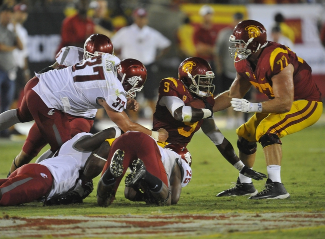 September 7, 2013; Los Angeles, CA, USA; Southern California Trojans wide receiver Marqise Lee (9) is brought down by the Washington State Cougars defense during the second half at the Los Angeles Memorial Coliseum. Mandatory Credit: Gary A. Vasquez-USA TODAY Sports