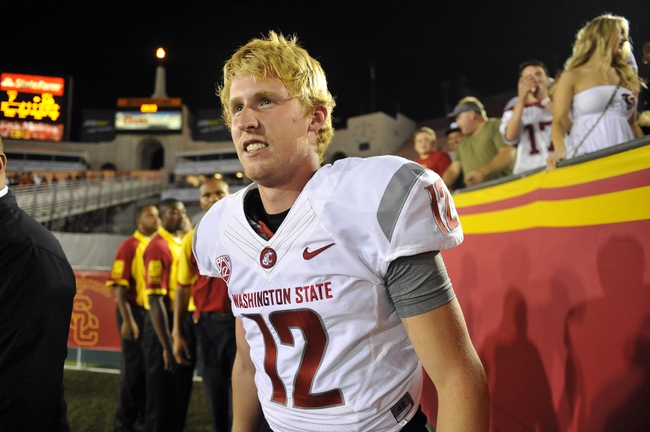 September 7, 2013; Los Angeles, CA, USA; Washington State Cougars quarterback Connor Halliday (12) celebrates the 10-7 victory against the Southern California Trojans at the Los Angeles Memorial Coliseum. Mandatory Credit: Gary A. Vasquez-USA TODAY Sports