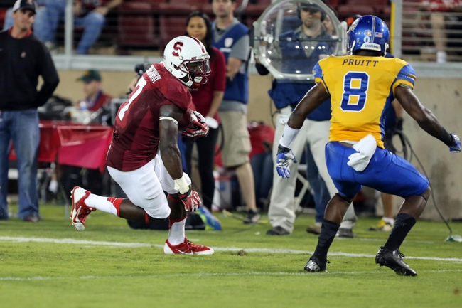 Sep 7, 2013; Stanford, CA, USA; Stanford Cardinal wide receiver Ty Montgomery (7) runs for a touchdown past San Jose State Spartans cornerback Jimmy Pruitt (8) during the third quarter at Stanford Stadium. The Stanford Cardinal defeated the San Jose State Spartans 34-13. Mandatory Credit: Kelley L Cox-USA TODAY Sports