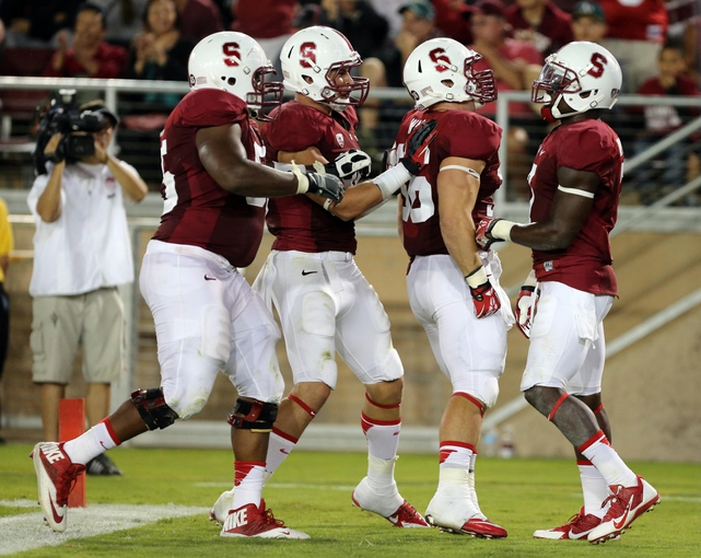 Sep 7, 2013; Stanford, CA, USA; Stanford Cardinal wide receiver Ty Montgomery (right) celebrates with teammates after scoring a touchdown against the San Jose State Spartans during the third quarter at Stanford Stadium. The Stanford Cardinal defeated the San Jose State Spartans 34-13. Mandatory Credit: Kelley L Cox-USA TODAY Sports